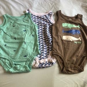 Carters trio of sleeveless bodysuits.